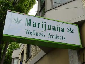 oregon marijuana dispensaries wellness sign