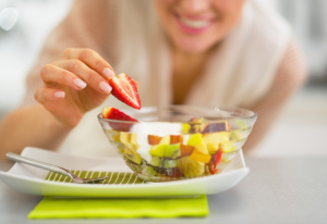 Woman Eating Fruit Salad Healthy Munchies