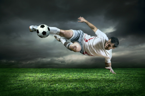 Man Kicking Soccer Ball on Field Futbol