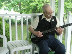 Old Man Grandpa on Porch with Guitar