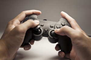 Hands Holding Playstation Controller